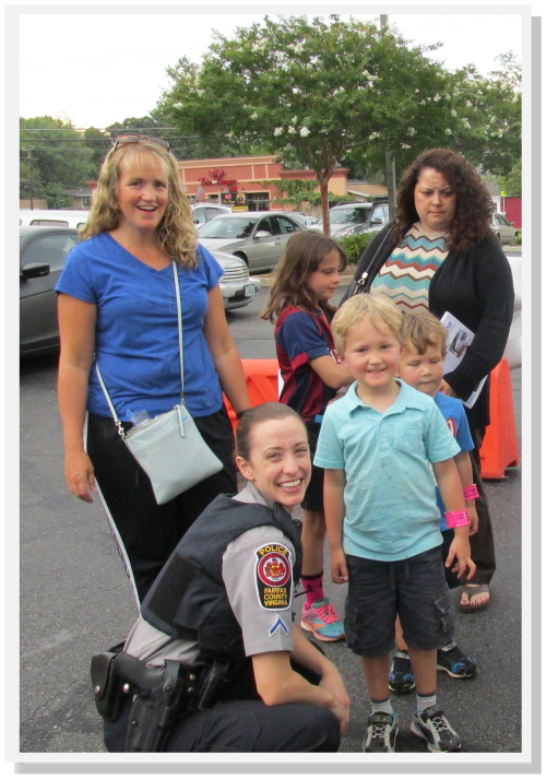 Fairfax County Community Police Officers greeting young residents.